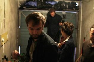 Writer/ Direcotr Tom Ryan preparing the set for a scene.