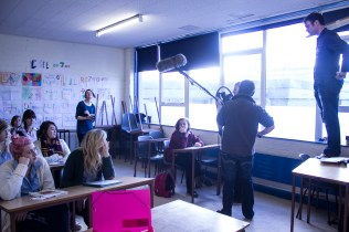 The cast and crew filming a scene in the school.
