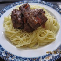 Angel hair pasta with ribs cooked in tomato and red wine sauce :x