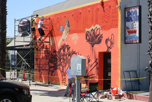 Artist Gail Werner working on her mural.