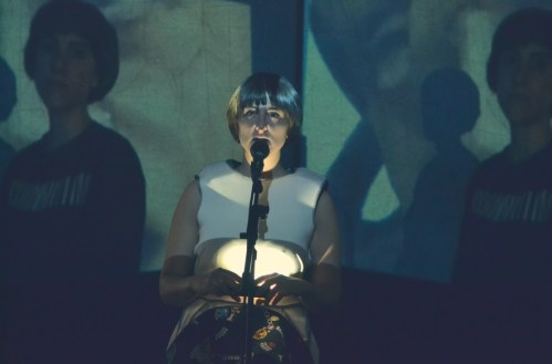 Electronic music from tape with live vocals and video background - singer Nikki Sharpp.
