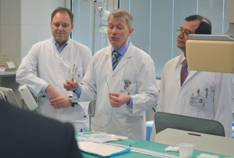 Christian Hoppe (center), assistant medical director at Cologne's cardiac center with two co-workers.