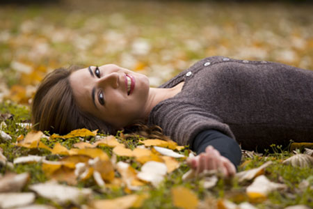 woman-relaxing-in-leaves-sm