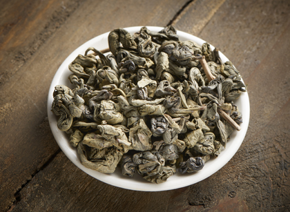 Chinese gunpowder tea is rolled by hand.