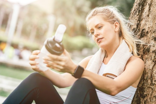 girl drinking the best pre-workout