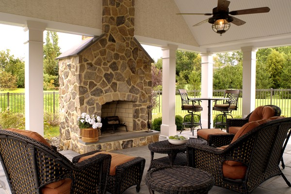 outdoor living space with fireplace landscape design   Transforming Decor Home Staging and