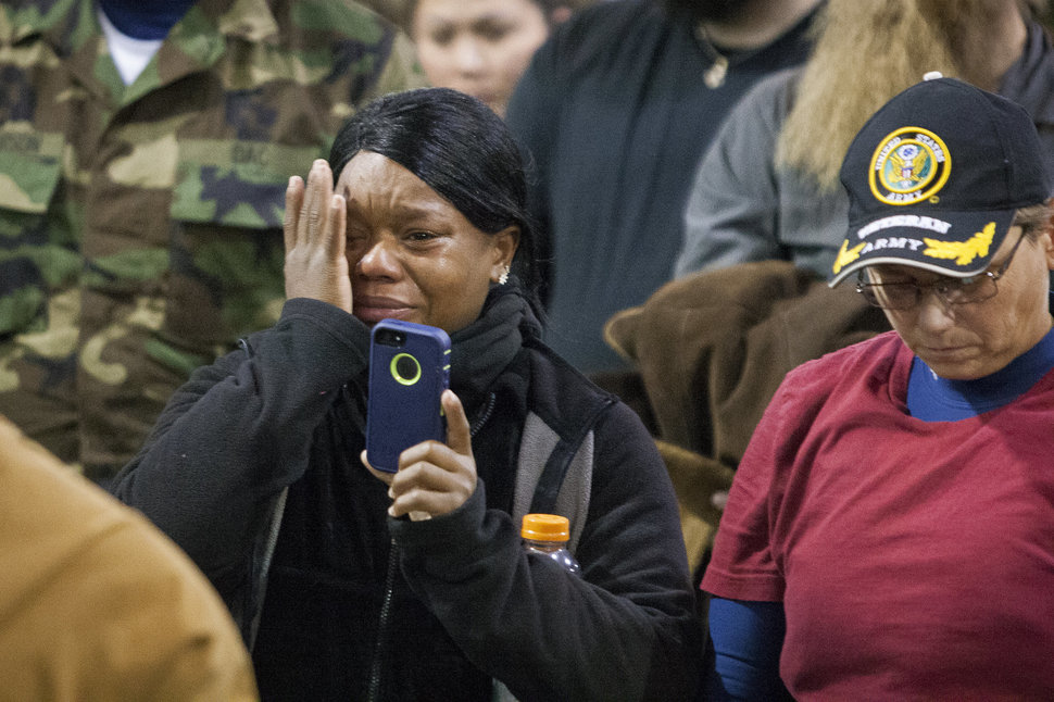 Veteran Tatian McLee wipes tears from her eyes as she films Lakota elders speak during a forgiveness ceremony for veterans at the Four Prairie Knights Casino & Resort on the Standing Rock Sioux Reservation on Monday, Dec. 5, 2016.