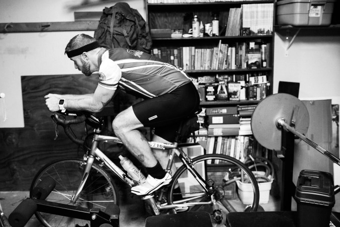 Pedaling on my bike trainer in the garage.