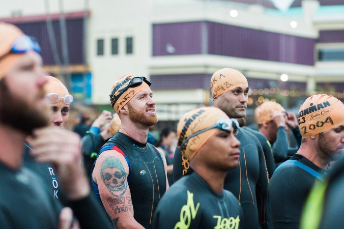 Me standing with other triathletes in the swim chute before Ironman 70.3 Santa Cruz.