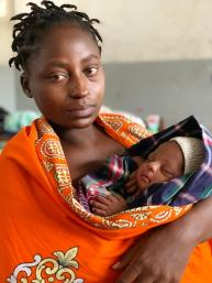 18 March 2019 Anastasia, 29 just gave birth 2 weeks ago. In the middle of the night she said she got scared when she heard the cyclone and fled to a church nearby. She has been so stressed that she canÕt think of a name to give her baby boy. She found shelter at a school turned into a shelter and hope she can go home soon. Today she received food from WFP for her and her 3 children. WFP/Deborah Nguyen