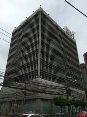 Brutalist buildings along the Suriwongse Road