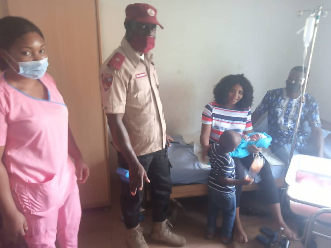 FRSC official with the pregnant woman in Ajao.