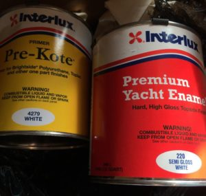 Rolling on Interlux Yacht Paint on the Westfalia pop top.