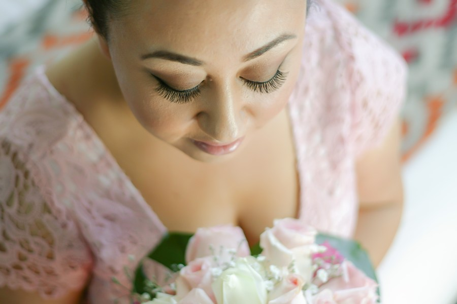 Sydney wedding bride looks down at her beautiful bouquet