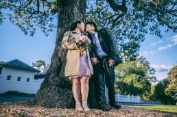 Australian and kiwi wedding couple kiss under the tree