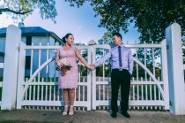 Beautiful kiwi bride and australian groom hold hands at parramatta park
