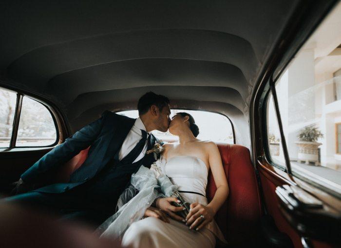 Sydney wedding couple kiss in the rolls royce