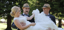 Bride is lifted up by groom and laughs