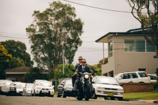 groom travels by motorbike to ceremony