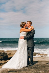 Bride & groom kissing each other on the wedding day