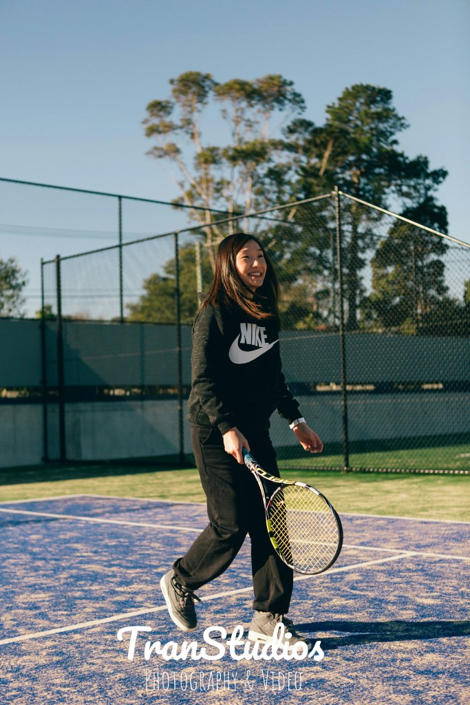 engaged woman playing tennis