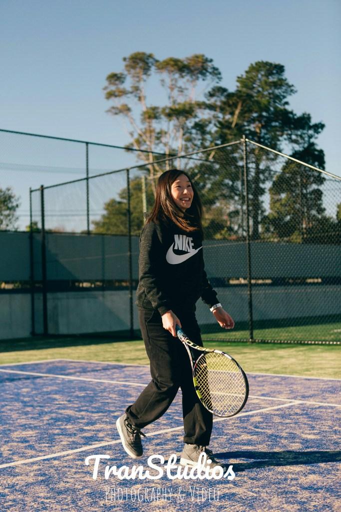 engaged woman playing tennis