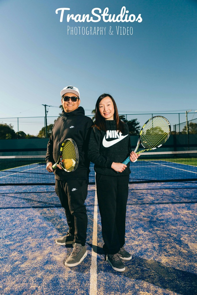 beautiful engaged couple posing at waitara tennis courts for engagement photoshoot