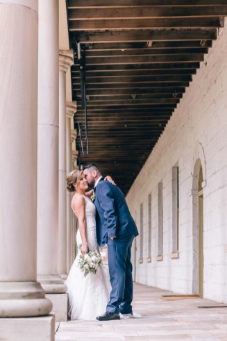 bride and groom kissing at the mint sydney wedding