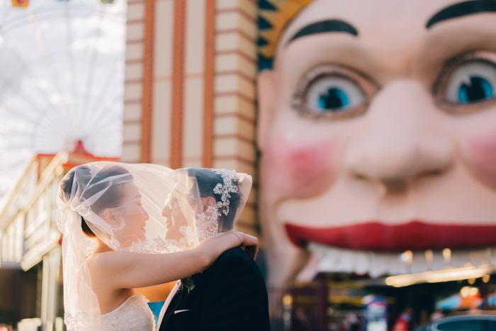 Beautiful bride and groom at luna park wedding photography sunset