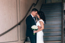 Uruguayan bride and groom on staircase