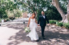 bride and groom walk at government house wedding