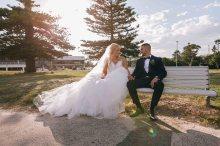 Australian bride and arabic groom sitting on a bench