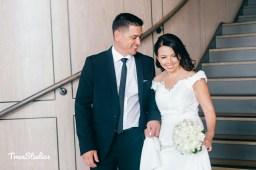Australian uruguayan bride and groom walking down stairs_01