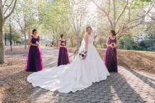 Beautiful bridesmaids look at the bride at Bicentennial Park Homebush Sydney_12