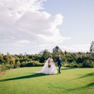 Bride and groom holding hands at Stonecutters ridge golf club_06