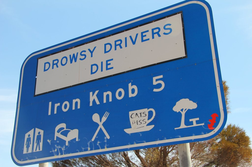 Australian road signs.  Urbane they are not.  Cup of cats piss anyone?