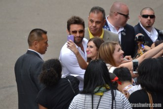 Hugh Jackman poses for a selfie with a fan at Comic Con 2013