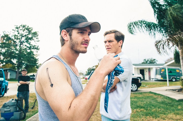 99HOMES_01706-01708_R_COMP_CROP (l to r) Andrew Garfield stars as 'Dennis Nash' and Michael Shannon as 'Rick Carver' in Broad Green Pictures release, 99 HOMES. Credit: Hooman Bahrani / Broad Green Pictures