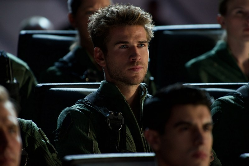 Fighter pilot Jake Morrison (Liam Hemsworth, center) and his squadron are briefed on plans to combat the alien invasion.
