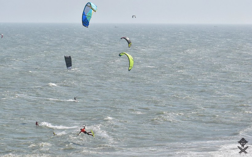 kitesurfer doing big air handle pass during kitesurfing competition in Mui Ne Vietnam 2018