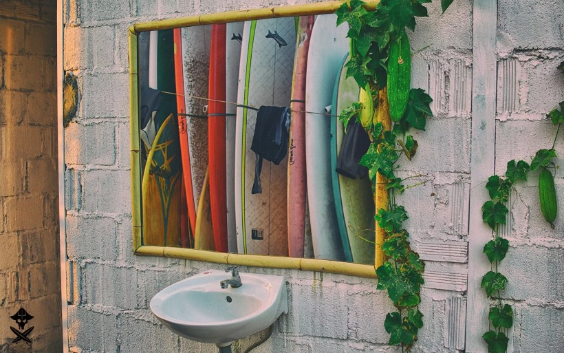 above the sink is a mirror that reflects surf boards on Vietnam Surf Camping in best kitesurfing spot Phan Rang in 2018