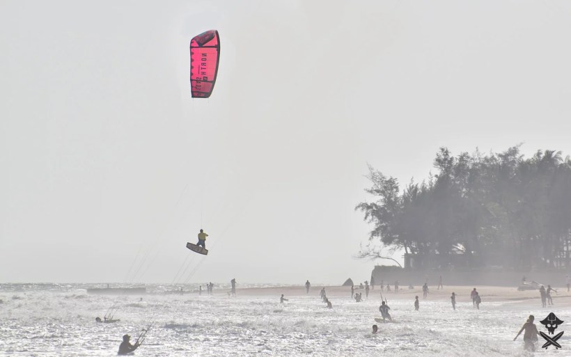 kiteboarder with north purple kite doing kite loop during big air competition by c2sky kite center in Vietnam Mui Ne beach 2018