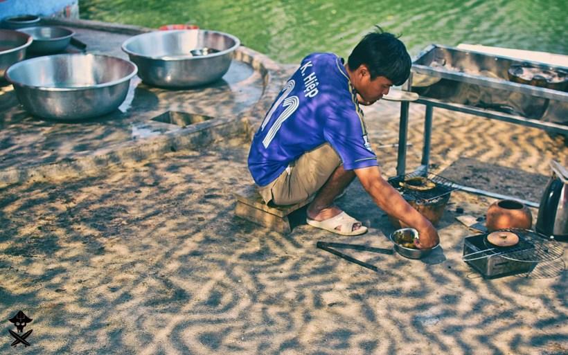 portrait of a vietnamese man preparing barbecue
