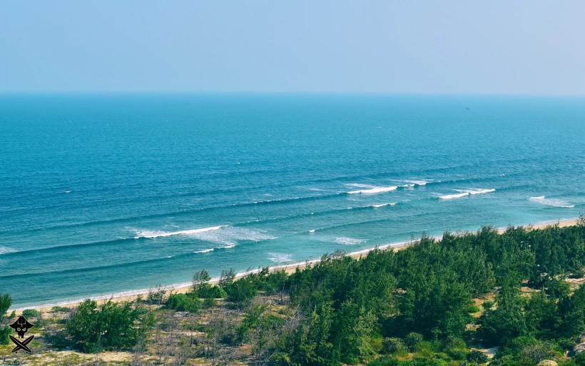 view at the unknown beach somewhere in vietname with long lines of beautiful waves great for surfing