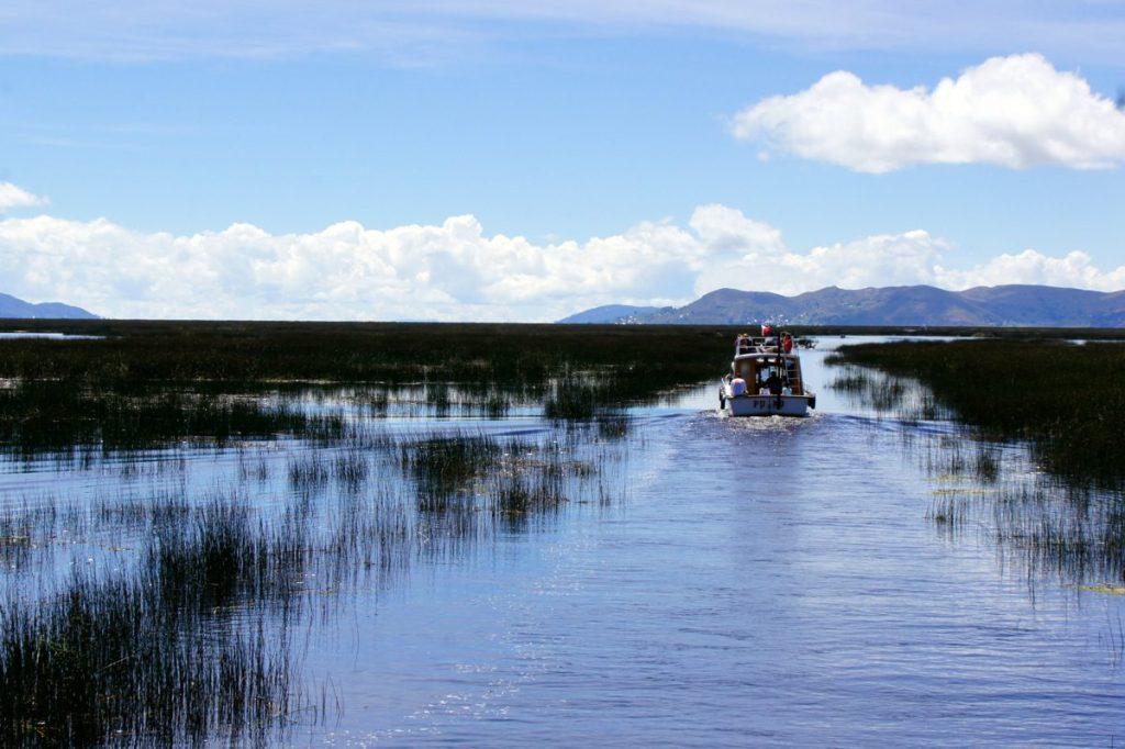 A speedboat gliding across Lake Titicaca