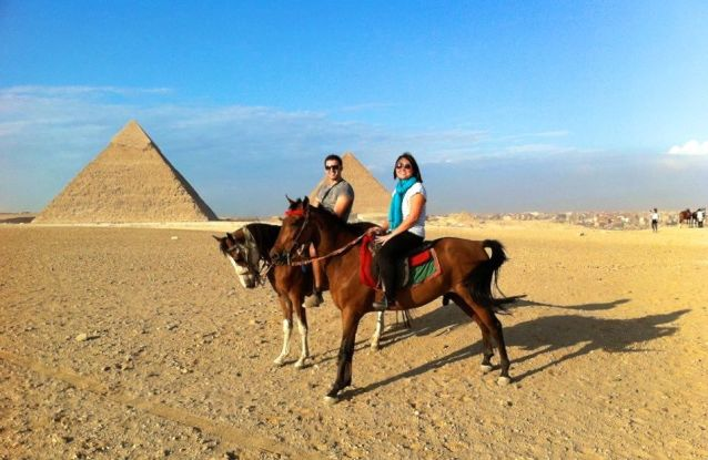 Riding Horses next to the Pyramids of Giza