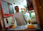 Happy hot dog vendor