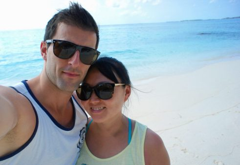 Wandering around Maafushi in tank tops