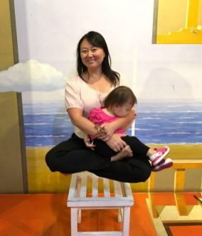 There are skills you have to pick up when you become a mother. Levitating with your daughter in your lap isn't one of them...
