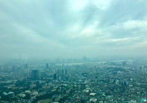 The vast city below